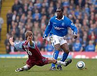 Photo. Glyn Thomas, Digitalsport<br /> Birmingham City v Aston Villa <br /> Barclays Premiership. 20/03/2005.<br /> Aston Villa's Mathieu Berson (L) slides in to tackle Emile Heskey.