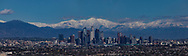 Los Angeles City Skyline with snow on the San Gabriel mountains. Los Angeles skyline.