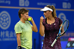 WUHAN, Sept. 29, 2018  Elise Mertens (R) of Belgium and Demi Schuurs react during the doubles final match against Andrea Sestini Hlavackova and Barbora Strycova of the Czech Republic at the 2018 WTA Wuhan Open tennis tournament in Wuhan, central China's Hubei Province, on Sept. 29, 2018. Mertens and Schuurs won 2-0 and claimed the title. (Credit Image: © Song Zhenping/Xinhua via ZUMA Wire)