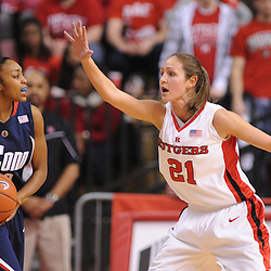Mar 2, 2009; Piscataway, NJ, USA; Rutgers forward Heather Zurich (21) defends Connecticut guard Renee Montgomery (20) during the second half of Rutgers game against nationally rated #1 Connecticut at the Louis Brown Athletic Center.  Connecticut won 69-59 to finish their regular season a perfect 30-0.