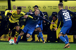 DORTMUND, Dec. 17, 2017  Pierre-Emerick Aubameyang (1st L) of Dortmund fights for the ball during the Bundesliga match between Borussia Dortmund and TSG 1899 Hoffenheim at Signal Iduna Park on December 16, 2017 in Dortmund, Germany. Dortmund won 2-1. (Credit Image: © Joachim Bywaletz/Xinhua via ZUMA Wire)