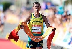 Australia's Dane Bird-Smith celebrates taking gold in the Men's 20km Race Walk Final at Currumbin Beachfront during day four of the 2018 Commonwealth Games in the Gold Coast, Australia.