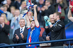 Inverness Caledonian Thistle's Graeme Shinnie, lifts the cup. Falkirk 1 v 2 Inverness CT, Scottish Cup final at Hampden.