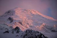 Mont Blanc glows at sunset above Chamonix, France.