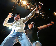 Country music artists Chris Cagle and Clay Walker have some fun as the perform during the Hot Rockin 4th festival in Ogden Utah, 2006.