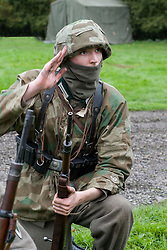 A Re-enactor portrayiing a German panzer grenadier from the Grossdeutschland Division during a battle battle re-enactment in on Pickering Showground<br /> <br /> 17/18 October 2015<br />  Image © Paul David Drabble <br />  www.pauldaviddrabble.co.uk