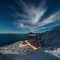 Winter view on moonlit night over Haukland beach from Mannen, Vestvågøy, Lofoten Islands, Norway