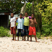 Four curious papuan boys posing for the photo.