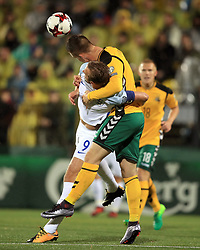 England's Harry Kane (left) battles with Lithuania's Linas Klimavicius during the 2018 FIFA World Cup Qualifying Group F match at the LFF Stadium, Vilnius.