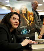 """Stephenie Meyer, author of """"The Host"""" and the Twilight series, signs books at the Barnes & Noble on Northwest Highway in Dallas on Tuesday, March 12, 2013. (Cooper Neill/The Dallas Morning News)"""