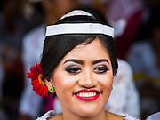 19 JULY 2016 - TAMPAKSIRING, GIANYAR, BALI, INDONESIA: A woman participates in the first day of a ceremony to honor the anniversary Pura Agung temple, one of the most important Hindu temples on Bali. This year's ceremony is the most important in years because it falls on the 50 year cycle of the temple's founding. This year's ceremony lasts for 11 days.      PHOTO BY JACK KURTZ