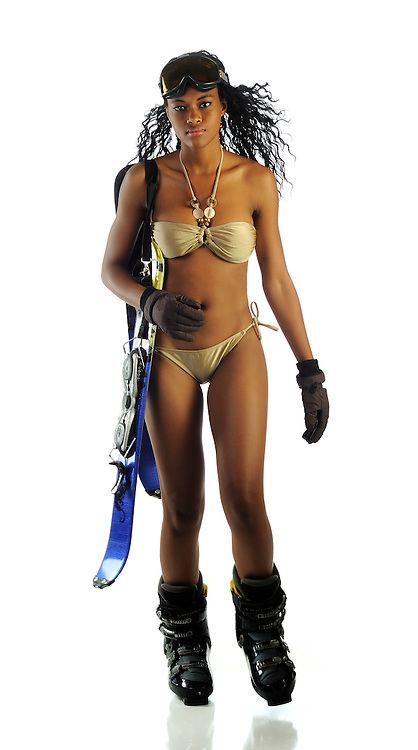 African-American girl in bikini with ski gear.  Snow bunny
