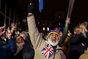 Remain protesters pro-EU celebrate in Westminster after the result of MPs Meaningfull EU Brexit vote which eventually brought about a massive defeat for Prime Minister Theresa Mays Conservative government, on 15th January 2019, in Westminster, London, England.
