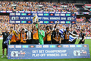Michael Dawson  of Hull City lifts the Sky Bet Championship Playoff Trophy with his teammates. Skybet football league Championship play off final match, Hull city v Sheffield Wednesday at Wembley Stadium in London on Saturday 28th May 2016.<br /> pic by John Patrick Fletcher, Andrew Orchard sports photography.