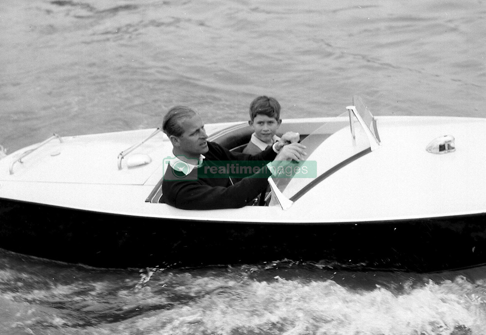 The Prince of Wales with his father, the Duke of Edinburgh during a motorboat race up the river Medina at Cowes, Isle of Wight.