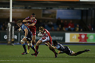 Rhys Patchell of the Scarlets © tries to break the tackle from Steven Shingler ® of Cardiff Blues. Guinness Pro12 rugby match, Cardiff Blues v Scarlets at the BT Cardiff Arms Park in Cardiff, South Wales on Friday 28th October 2016.<br /> pic by Andrew Orchard, Andrew Orchard sports photography.