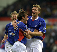 Fotball: Dunfermline v Rangers, Scottish Premier League, East EDnd Park, Dunfermline. Pic Ian Stewart, Saturday 11th. August 2001<br />Ricksen and flo celebrate after flo's goal