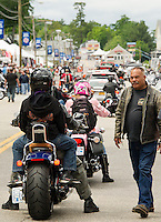Weirs Boulevard sees a steady flow of traffic over the weekend to begin Laconia's 93rd Motorcycle Week.  (Karen Bobotas/for the Laconia Daily Sun)