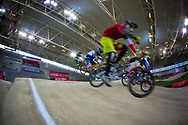 Riders on the first jump during the practice session at the 2014 UCI BMX Supercross World Cup in Manchester.