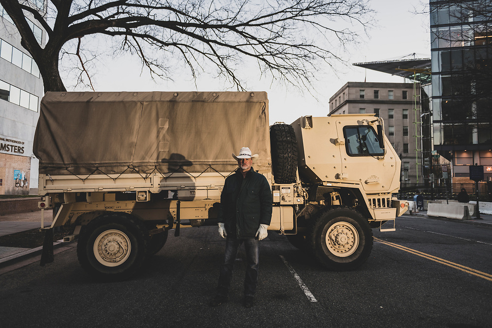 Washington DC, USA - January 18, 2021: William Wieting, aka Mustang Medic, poses for a portrait beside a National Guard truck parked on New Jersey Avenue NW outside the Hyatt Regency.