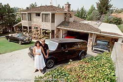 Arlen Ness and his wife Bev in front of their Castro Valley home with the '77 Ford Van, 1972 Rolls Royce Cornich convertible and the 1956 Ford pick-up in the garage. Photograph ©Michael Lichter 1987