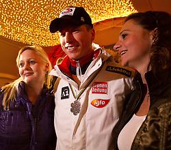 09.02.2011, Tirol Berg, Garmisch Partenkirchen, GER, FIS Alpin Ski WM 2011, GAP, Herren Super G, Sieger im Tirol Berg, im Bild silber Medaillen Gewinner Hannes Reichelt (AUT) mit zwei jungen Damen// silver Medal for Hannes Reichelt (AUT) with two young ladies  during Men Super G, Fis Alpine Ski World Championships in Garmisch Partenkirchen, Germany on 9/2/2011. EXPA Pictures © 2011, PhotoCredit: EXPA/ J. Groder