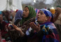 November 21, 2018 - Srinagar, Jammu and Kashmir, India - Kashmiri Muslim women pray during the ceremony marking the birthday anniversary of Prophet Mohammad, Mawlid al Nabi, at the Hazartabal shrine in Srinagar, the summer capital of Indian controlled Kashmir, on November 21,2018. (Credit Image: © Faisal Khan/ZUMA Wire)
