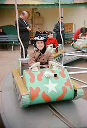 boy in the 1960's enjoying a ride on a carnival ride