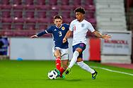 Greg Taylor (#3) of Scotland U21s (Kilmarnock FC) tackles Reiss Nelson (#19) of England U21s (Hoffenheim, loan from Arsenal) during the U21 UEFA EUROPEAN CHAMPIONSHIPS match between Scotland and England at Tynecastle Stadium, Edinburgh, Scotland on 16 October 2018.