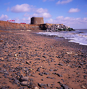 A294PC Martello tower from Napoleonic war eroded by the sea Bawdsey Suffolk England
