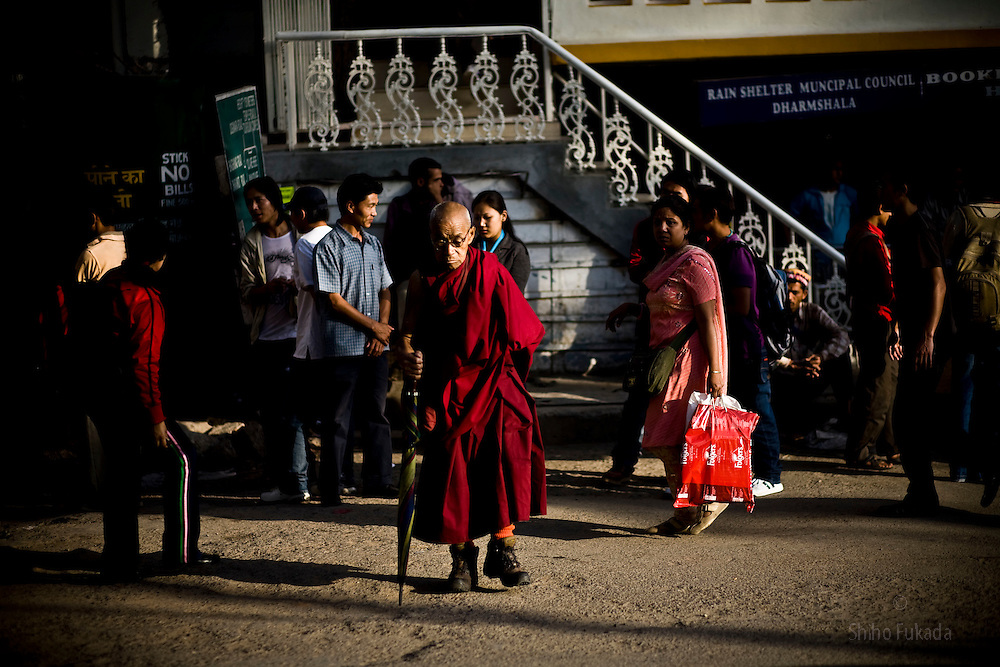 INDIA - Life in Exile (Tibetan Refugees)<br /> An old monk makes his way through town of McLeod Ganj, Dharamsala, India, where the Dalai Lama settled after fleeing Tibet in 1959 after a failed uprising against Chinese rule, May 25, 2009.