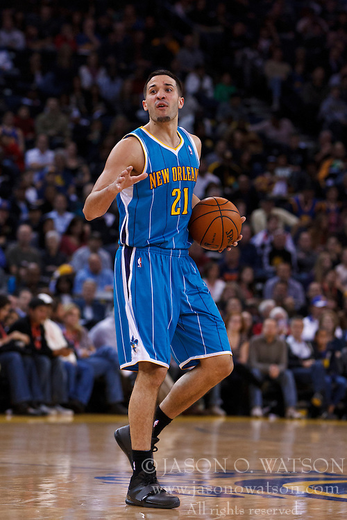 Mar 28, 2012; Oakland, CA, USA; New Orleans Hornets point guard Greivis Vasquez (21) dribbles the ball against the Golden State Warriors during the second quarter at Oracle Arena. New Orleans defeated Golden State 102-87. Mandatory Credit: Jason O. Watson-US PRESSWIRE
