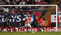 Photo: Chris Ratcliffe.<br />Charlton Athletic v Brentford. The FA Cup. 18/02/2006.<br />Isaiah Rankin (obscured left) of Brentford scoring a late consolation past Thomas Mhyre in the Charlton goal.