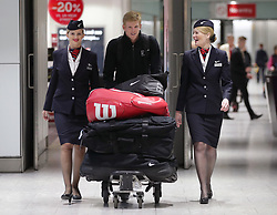 Great Britain's Kyle Edmund, flanked by BA Ambassadors Tina (left) and Jane, arriving back at Heathrow Airport, London, after exceeding expectations by reaching the semi final stage of the Australian Open in Melbourne earlier this week.
