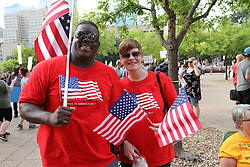 Husband and wife Tony and Calisa Green come to show their disdain for white supremacists and Donald Trump during the Anti Racism Rally in front of City Hall in downtown Dallas on Saturday August 19, 2017.