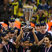 Fenerbahce's players Lynn Terence GREER (C), Omer ONAN (L), Damir Kaan MRSIC (R) celebrate with the BEKO Basketball League Champions Cup trophy during their Turkish Basketball league Play Off Final Sixth Leg match Fenerbahce Ulker between Efes Pilsen at the Abdi Ipekci Arena in Istanbul Turkey on Wednesday 02 June 2010. Photo by Aykut AKICI/TURKPIX