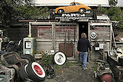 Car Photography from Automotive Photographer Randy Wells, Image of a man entering an auto parts storage building in McMinnville, Oregon, Pacific Northwest