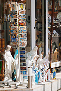 A shop with souvenirs for pilgrims, with things for sale. Madonna statue, rosary beads, post cards.. Medugorje pilgrimage village, near Mostar. Medjugorje. Federation Bosne i Hercegovine. Bosnia Herzegovina, Europe.