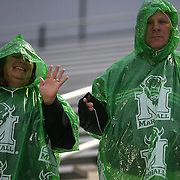 Marshall fans wait in the rain prior to an NCAA football game between the Marshall Thundering Herd and the Central Florida Knights at Bright House Networks Stadium on Saturday, October 8, 2011 in Orlando, Florida. Thunderstorms are expected for this evenings game.(Photo/Alex Menendez)