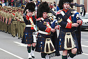 Queensland Police Pipe Band marching in 2014 ANZAC day parade - Hobart <br /> <br /> Editions:- Open Edition Print / Stock Image