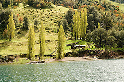 Chile, Lake Country: Rustic homestead on the side of Lake Todos Los Santos.  People survive here by raising animals for cheese and sausage..Photo #: ch672-33224..Photo copyright Lee Foster www.fostertravel.com, lee@fostertravel.com, 510-549-2202.