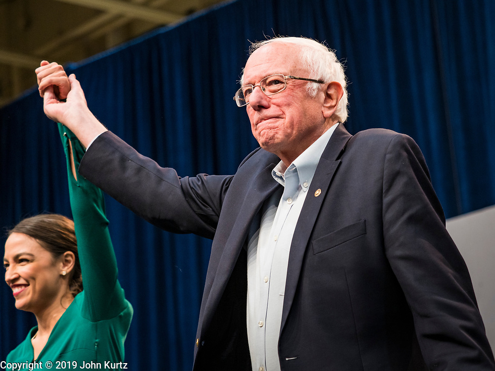 """09 NOVEMBER 2019 - DES MOINES, IOWA: Congresswoman ALEXANDRIA OCASIO-CORTEZ (D-NY) and US Senator BERNIE SANDERS (I-VT) at a climate change town hall organized by Sanders' presidential campaign. Sanders and Ocasio-Cortez hosted the """"Climate Crisis Summit"""" at Drake University in Des Moines. More than 2,000 people attended the event. Sanders, an independent, is running to be the Democratic nominee for the 2020 US Presidential election. Iowa holds the first in the country selection contest with state caucuses on Feb. 3, 2020.               PHOTO BY JACK KURTZ"""