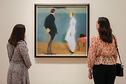 "© Licensed to London News Pictures. 17/07/2019. London, UK. Members of staff view Helene Schjerfbeck's painting ""Tapesty 1914-17"" at Royal Academy of Arts during the preview of her first ever exhibition in the UK. The exhibition features around 65 portraits, landscapes and still life, charting the development of Helene Schjerfbeck's work from a naturalistic style inspired by French Salon painters in the early 1880s, to a radically abstracted and modern approach from the turn of the twentieth century onwards. The exhibition runs  from 20 July to 27 October 2019. Photo credit: Dinendra Haria/LNP"