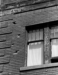 November 17, 2016 - Michigan, U.S. - Bullet holes in a building on 12th street during the 1967 Detroit riot. (Credit Image: © Detroit Free Press via ZUMA Wire)