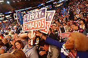 Delegates pass out signs during the Democratic National Committee Convention at the Fleet Center in Boston, MA. 7/27/2004
