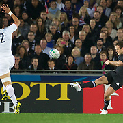 Dan Carter, New Zealand, kicks past Maxime Mermoz, France, during the New Zealand V France, Pool A match during the IRB Rugby World Cup tournament. Eden Park, Auckland, New Zealand, 24th September 2011. Photo Tim Clayton...