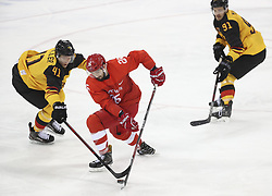 PYEONGCHANG, Feb. 25, 2018  Vyacheslav Voinov (C) of Olympic athletes from Russia vies for the puck with Jonas Muller (L) of Germany during men's ice hockey final between Germany and Olympic athletes from Russia at Gangneung Hockey Centre, in Gangneung, South Korea, Feb. 25, 2018. The Olympic Athletes from Russia team defeated Germany 4:3 and won the gold medal. (Credit Image: © Han Yan/Xinhua via ZUMA Wire)