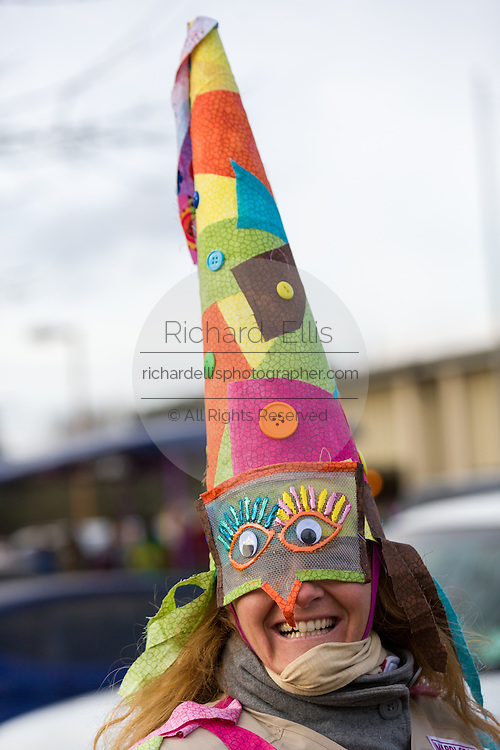 Traditional Cajun Mardi Gras costumed reveler during the Courir de Mardi Gras chicken run on Fat Tuesday February 17, 2015 in Eunice, Louisiana. Cajun Mardi Gras involves costumed revelers competing to catch a live chicken as they move from house to house throughout the rural community.