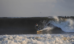 © Licensed to London News Pictures. 27/03/2014<br /> <br /> Cleveland, England<br /> <br /> Surfer Sky Shaw from Saltburn rides a wave on the north east coast of England during an early morning surf.<br /> <br /> Photo credit : Ian Forsyth/LNP