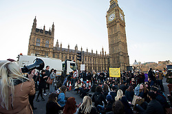 © Licensed to London News Pictures. 19/01/2016. London, UK. Students block Westminster Bridge next to the houses of parliament to protest against cuts to education.  A motion to be put forward by Labour on Tuesday afternoon will call on the government to reverse its decision to remove the last non-repayable grants to help with students' living costs. Photo credit: Ben Cawthra/LNP